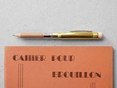 Brass pencil.