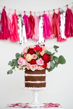 Use artificial flowers on a deconstructed cake to recreate this look from modwedding.com