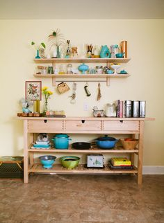 love this large table in the kitchen with the turquoise accents.