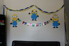 Of course we had to have some fun decor -- so I bought a couple posterboards at the dollar store and cut out some minions for the walls. I found a bright yellow disposable plastic tablecloth at Walmart for a little over a buck, which I ended up cutting to fit not only my kitchen table but also two smaller picnic tables we brought in. Also found at the dollar store: bright blue paper plates, bright blue and yellow crepe paper streamers