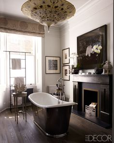 Room of the Day ~ charming London bath with stylish bath, light, floor, fireplace and accessories.  See other half of this bath. 1.22.2014