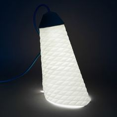 Paris designer Jean-Sébastien Lagrange has created a lamp rolled from a single sheet of a folded parchment