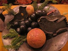 Old Bowl...filled with pine, oranges,  prim tin cookie cutters.