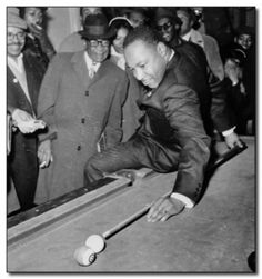 Martin Luther King Jr. sets up a trick shot during a trip to Chicago, 1966.