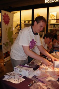 Dec 10 Mike from Manchester Branch helps visitors extract the life source (that's DNA) from strawberries at Manchester Science Festival. #science #volunteering #charity