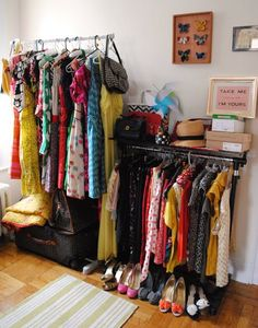 lack of closet.                                                                            this is what i did to create more space for my obsession with clothing. : )