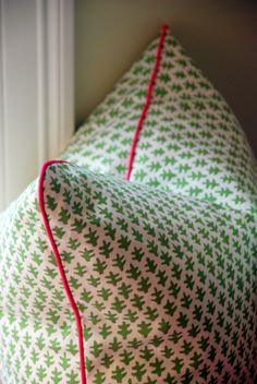 "Sister Parish ""Burmese"" Decorative Pillow Covers - Green and White Geometric Batik Print with Pink Piping"