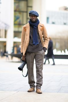Even thephotographers@Mercedes-Benz Fashion Weekknow how to dress well.  Photo by Chloe Zhao