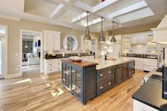 Cabinet on end of island, lighting, box-beam ceiling