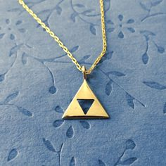 Triforce necklace by PicaPicaPress on Etsy, $18.00