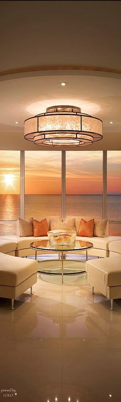 """Note that the orange pillows would not """"match"""" the view at any other time than sunset...wouldn't it be fun to have accent pillows to match the color of view for whatever time of day the party would be held?"""