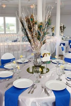 peacock feathers & lights - wedding centerpiece