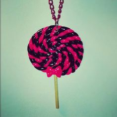 Small Hot Pink & Black Lollipop Necklace. $6.00, via Etsy.