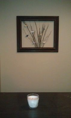"""The frame @ Goodwill for $2, and popped out the back and glass. Staple gunned the sticks to the back. They're a $4 """"cinnamon broom."""" The birds are made out of scrapbooking leftovers."""