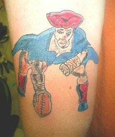 Cartoon Joe Pats------I remember when I made my first tattoo.  This is such a horrible depiction of the classic New England Patriots logo that it isn't even funny. It is sad.  Was this done by a child?
