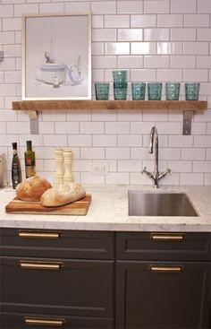 Dark bottom cabinets, white upper cabinets, subway tile, reclaimed wood open shelves