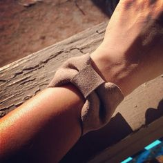 Bow shaped leather cuff by deMuerto on Etsy, $12.00