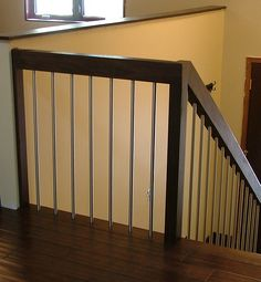 stair railing idea....like the clean look. Lighter wood with dark iron for my house.