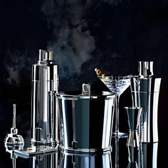 Tiffany barware: oilcan vermouth dispenser in sterling silver, Century cocktail shaker in sterling silver, Century ice bucket in sterling silver, Plaid martini glass in crystal, Century double jigger in sterling silver, and Tiffany 1837™ cocktail shaker. #TiffanyPinterest
