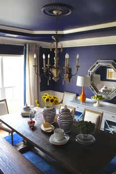 Erika Ward transforms an old playspace into a dazzling dining room makeover with products from Home Depot and Home Decorators Collection.