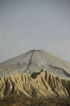 I think that's a weathering ash deposit at the base of a volcano...