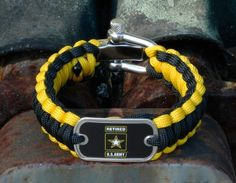 This is the Officially Licensed Regular Survival Bracelet of the Retired U.S. Army™ in black and yellow! Made from super strong military spec paracord and an authentic military dog tag. Perfect for showing your support for our troops! $41.90