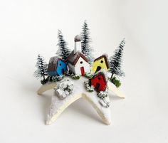 So cool.   Fairy Village In Winter Upon a Star - Tiny Landscaped Houses and Snow Covered Pine Trees by Bewilder and Pine. $32.00, via Etsy.