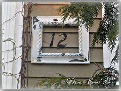 DIY:  Hang an empty picture frame around your house numbers.  It makes them stand out & it's something unexpected.