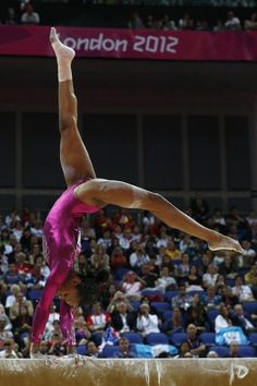 US gymnast Gabrielle Douglas performs on the beam during the artistic gymnastics women's individual all-around final at the 02 North Greenwich Arena in London on August 2, 2012 during the London 2012 Olympic Games. Douglas won the event.