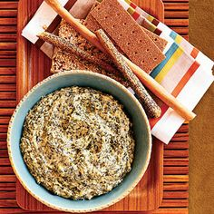 Warm Spinach-Artichoke Dip    This recipe cuts calories by using lima beans to create a creamy texture.    Ingredients: Lima beans, light mayo, fat-free cream cheese, dry mustard, Tabasco sauce, capers, artichoke hearts, frozen spinach, mozzarella cheese, Parmesan cheese, green onions, lemon juice