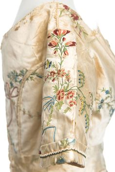 detail of tambour work, dress, 1830s, though the fabric is likely 18th century French. Charleston Museum work dresses