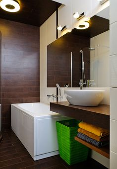 Inspiration from Bathrooms.com: Good lighting and great storage is a must in a spa bathroom to help keep the room feel truly streamlined. #bath #bathroom #spa #wetroom