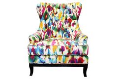 """I""""m on a mission to have a watercolor print upholstered chair."""
