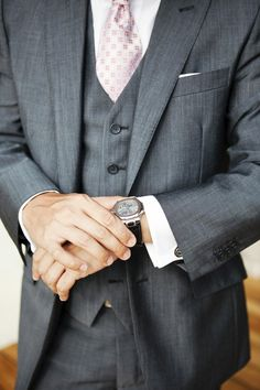 Grey suit and pink tie..
