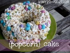 Welcome to Summer Party=Popcorn cake (like rice krispie squares)  16 c. popped popcorn (a little less than 3/4 c. unpopped)  1/4 c. butter  10.5 oz. package of marshmallows  1 large bag Peanut M's (I used the Easter ones!)  Mix and put in lightly buttered bundt pan (not sprayed or will taste funny) for 10 minutes. Then invert onto cake plate.