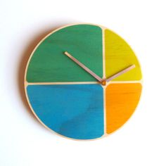 Hand made on plywood, this is a modern and colorful design. Love it! Oh, and it tells the time too.