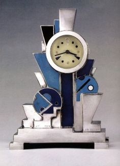 "gildedjuggernaut: Clock, Jean Goulden Silvered bronze and champlevéenamel, 1928 Talented and with a secure personal income from a wealthy upbringing, Goulden was not only a high-talented artist, but a supporter and collector of his friends' works, including that of Jean Dunand. ""A Greek Orthodox church situated on the secluded Mount Athos was the unlikely early training place and inspiration for Jean Goulden to learn the art of enameling during the years of the First World War. When he ..."