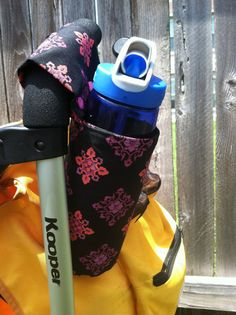 Cute Giant Universal Snap On Sling Cup Holder for Stroller, Grocery Cart Baskets, Highchiairs, Bikes, Wheelchairs, Almost Anywhere. $12.00,  Adult and child sizes available via Etsy.  https://www.facebook.com/LittleSewingShop?ref=hl