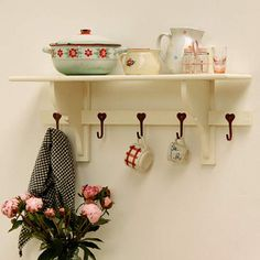 country cottage style kitchen shelf with hooks