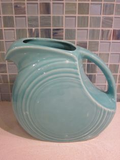 retro turquoise blue fiesta ware juice disc / disk pitcher - vintage collectible. $32.00, via Etsy.