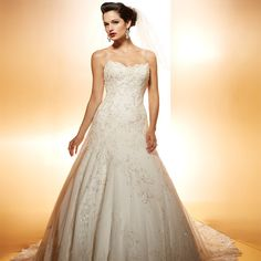 Ambiance~Distinctive Weddings and Events Matthew Christopher~Shimmering silvery embroidered Chantilly lace trails all over this lovely gown with a delicate strapless sweetheart neckline For Planning Help Call (410) 819-0046 MaryannJudy.com