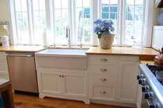 Ikea cabinet frames with custom doors, farmhouse kitchen with white painted cabinets, butcher block countertops