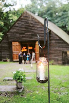 Shepherd hooks & mason jars light the way! Would be cute in the backyard and safe!