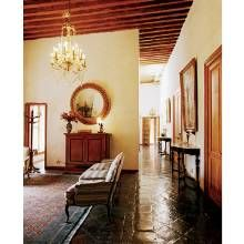 A sitting area and long corridor in the main living quarters showcase antiques collected over the years.