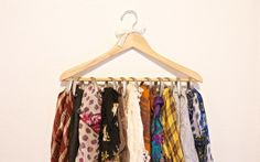 Wooden hanger + shower curtain rings = pretty scarf storage