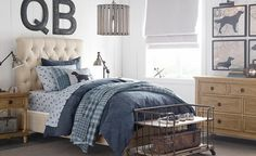 Traditional Boys Bedroom Design. Dog silhouette on map. Initials. a touch of industrial.