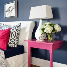 aww! A navy and pink bedroom! And I LOVE the  half nightstand; it doesn't take up too much space, but offers just enough for all the necessities.