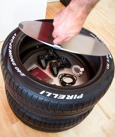 Cool idea for a hubby's man cave! Tire  glass table