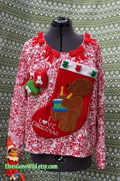 Ugly Christmas Sweater with Teddy Bear Stocking and Festive Print via Etsy.