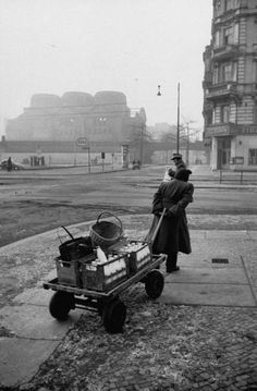 Milk woman making her early morning delivery. Photograph by Thomas D. McAvoy. West Berlin, Germany, 1954.